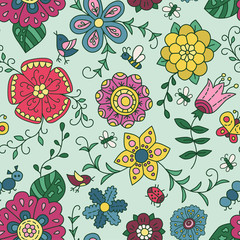 Doodle and cartoon flowers. Colorful seamless pattern