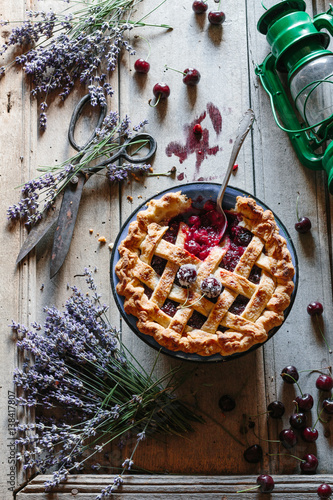 Photo  Cherry pie with a classic lattice crust on a vintage wooden table