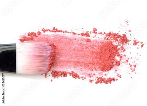 Valokuva  Close up of crushed blush on white background and cosmetic brush
