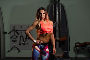 Fototapeta na wymiar Sexy Fitness Woman Posing In Gym