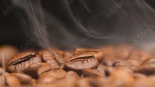 Deurstickers Koffiebonen MACRO: Smoke over a roasted coffee beans