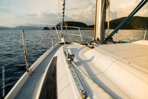 Fototapeta Sailing boat on the water of the ocean at sunset, and the outdoor lifestyle. obraz na płótnie