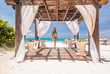 Woman at caribbean beach with pergola
