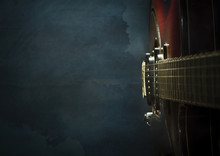 Close-up Of Old Electric Jazz Guitar On A Dark Blue Background