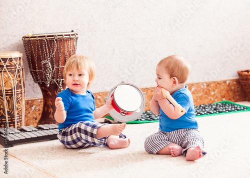 Obraz na plátne  Boys with musical instruments
