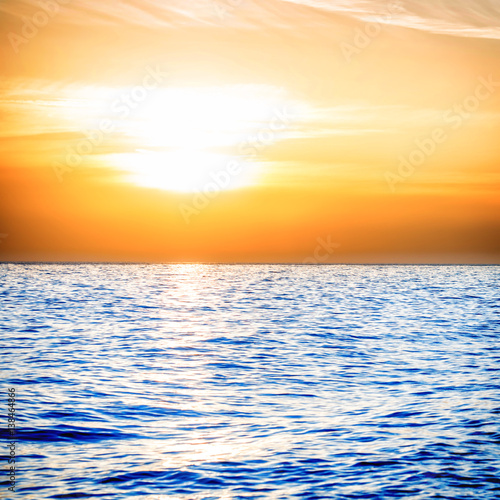 Sunset above the blue sea