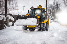 Snow Clearing. Tractor Clears The Road After Snowfall