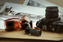 Photographic Film Rolls, Cassettes And Camera . Analog Film Strips Analog Photography.