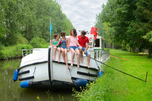 Family Vacation, Travel On Barge Boat In Canal, Happy Kids Having Fun On River Cruise Trip In Houseboat