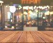 Wood table top with blurred light cafe or restaurant background