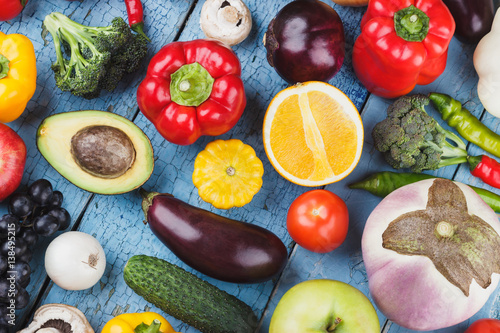 Photo Set of different colorful vegetables and fruits on the wooden background
