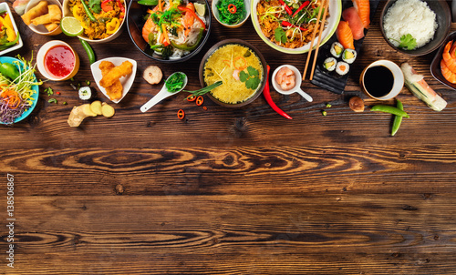 Photo  Asian food served on wooden table, top view, space for text