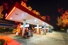 Gas Station Burned Out At Night Time.