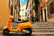 Orange vintage scooter on the background of Rome street