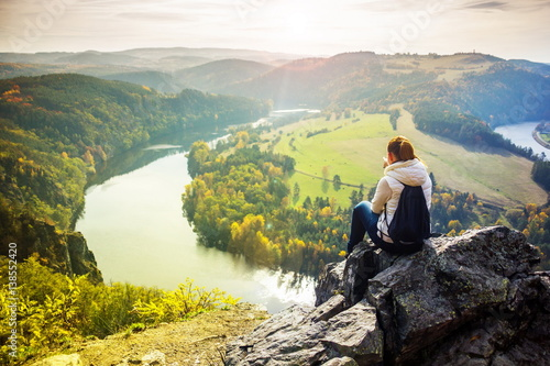 Girl looking at Vlatava river in Czech Republic Poster