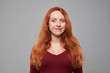 Studio shot of elated red hair young woman
