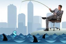 Businessman Fishing Out Dollar...
