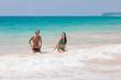 couple splashing around in the turquoise water