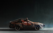Post - Apocalyptic Handmade Toy Car On Black Background With Smoke