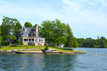 Island With House, Cottage Or Villa In Thousand Islands Region In Sunny Summer Day In Kingston, Ontario, Canada. 1000 Islands Near Gananoque, ON. Famous Canadian Tourist Vacation Routs.