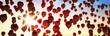 canvas print picture - Rote Luftballons im Abendhimmel mit Sonne