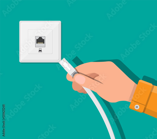 RJ45 LAN cable in hand and network socket Canvas Print