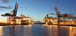 Leinwandbild Motiv Port with cranes and cargo ships // Hafen mit Kränen und Frachtschiffen