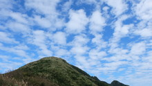 JiLong Mountain In JiuFen, Taiwan, On A Winter Day With Tiny Puffs Of Clouds