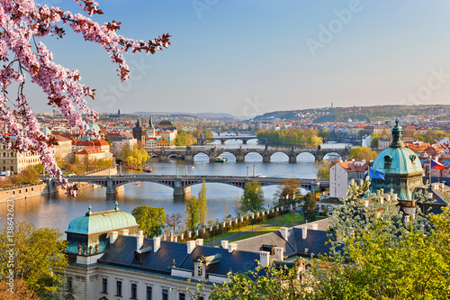 Poster Praag View on Vltava river and Prague at sunset