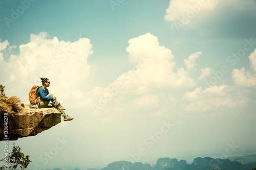 Obraz successful woman hiker enjoy the view on mountain peak cliff - fototapety do salonu