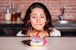 Woman on the diet craving to eat cake