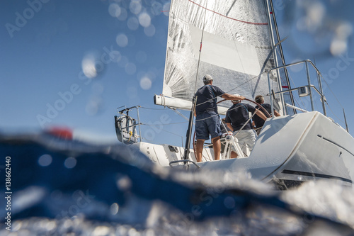 Aft of sailing boat with skipper from underwater view