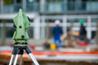 Surveyor equipment theodolite on tripod at building area