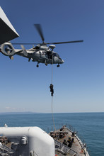 Military Helicopter And Military Ship