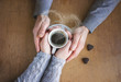 Cup of coffee for Breakfast in the hands of lovers. Selective focus.