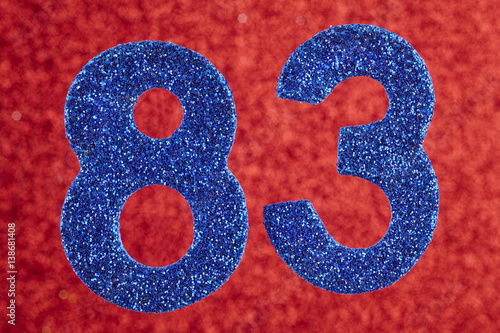 Poster  Number eighty-three blue color over a red background