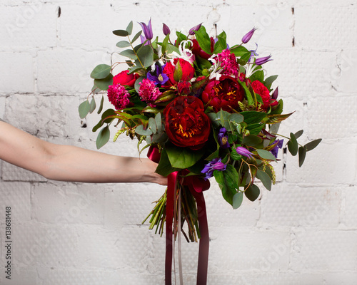 Fotografie, Obraz  Creative bouquet of flowers at arm's length, beautiful flowers as a gift beloved