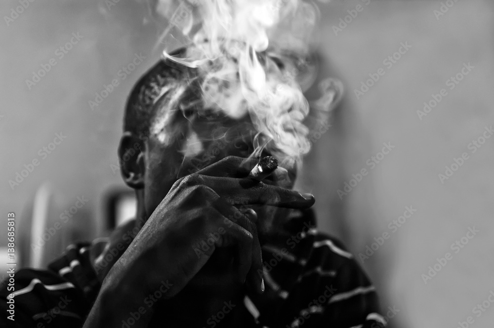 Fototapeta Close-up of African man smoking joint