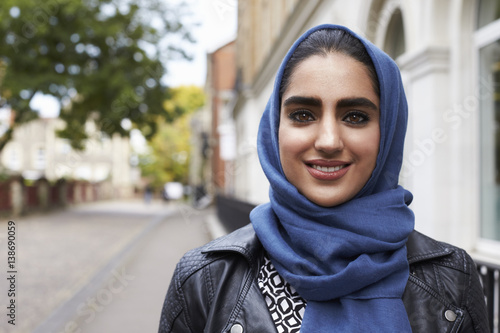 Photo Portrait Of British Muslim Woman In Urban Environment