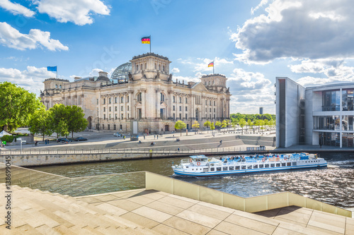Fotobehang Berlijn Berlin government district with Reichstag and ship on Spree river in summer, Berlin Mitte, Germany