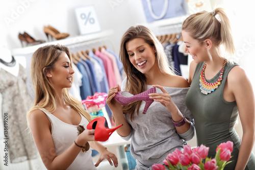 Fototapeta Group of happy friends shopping in store obraz
