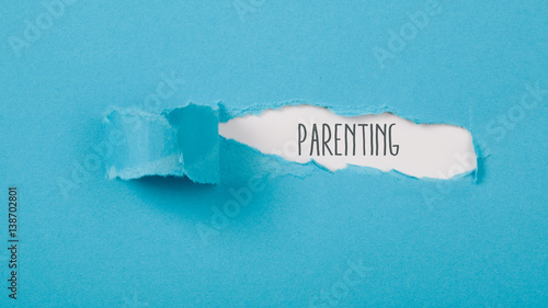 Fotografiet  Parenting message on Paper torn ripped opening