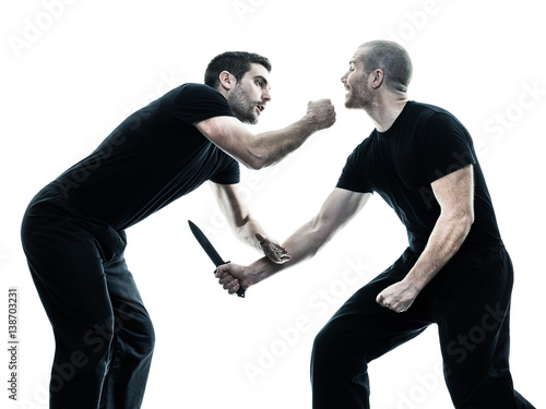 two caucasian men krav maga fighters fighting isolated silhouette on white backg Canvas Print