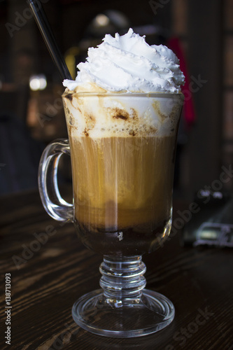 Foto op Canvas Chocolade Coffee cappuccino in a glass cup on wooden table