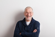 Senior Man In Blue Woolen Sweater, Studio Shot.