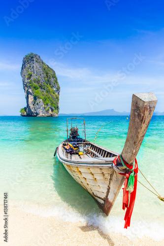 Thailand summer travel sea, Thai old wood boat at sea beach Krabi Phi Phi Island Phuket park on white sand blue sky emerald green ocean water.