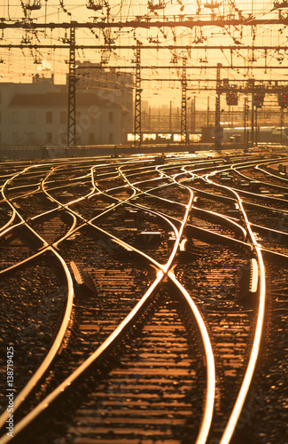 Photo Stands Railroad Sunrise over empty railroad tracks at Perrache station in Lyon, France. Shallow D.O.F.