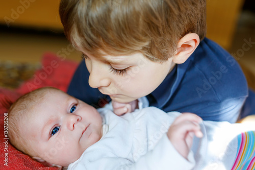 24493d8b7754a Happy little kid boy with newborn baby sister girl - Buy this stock ...