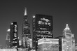 Black and white picture of Chicago downtown at night, Illinois, USA.