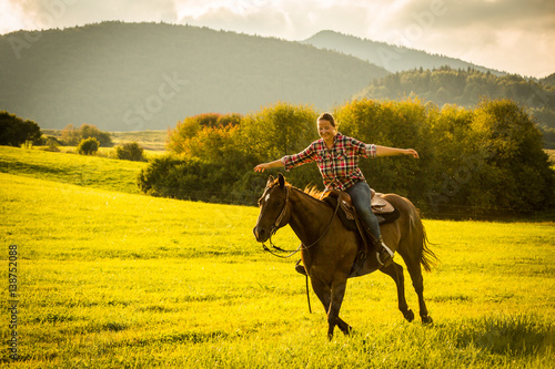 Photo  Girl with a blue and red mapped shirt with a horse in Slovakia
